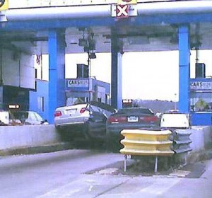 two-cars-crash-toll-booth1_