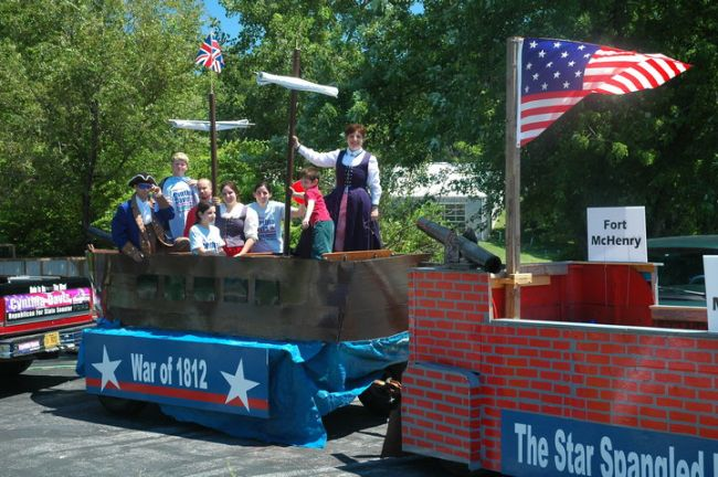 This is the float we used for several parades.  One trailer was made to simulate a British war ship and the other was made to represent Fort McHenry.  We played The Star Spangled Banner over a sound system and enjoyed watching people stand as we passed their section!  I liked reminding the parade watchers of the price that we paid to preserve our American independence.