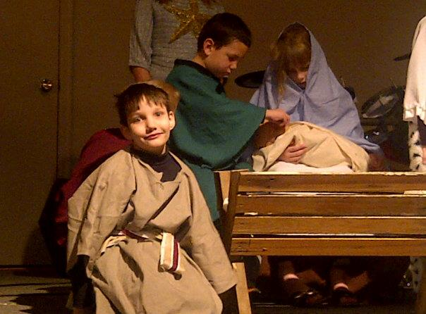 This is a picture of my son, Philip, when he played the part of a shepherd in a Christmas production.  He took time out of his role to smile for his mother.   During the business of this Holiday season, it's okay to step out of our roles long enough to remember what is really important, (like giving mom, or anyone else, a smile!)