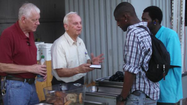 This is a picture someone snapped of my dad, Gordon Gosh, serving Bibles to people.  He volunteers for Feed My Peeps, but he also understands that feeding people is far more than just stuffing their stomachs.  It's feeding their souls as well.