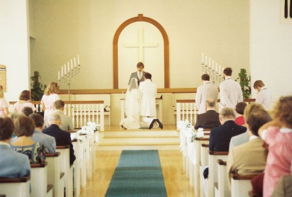 This photo was taken at my wedding nearly 35 years ago.  I selected this picture because it reflects the sacredness of the wedding vows.  Our guest on Home Front this week shares some insights on how some pastors are no longer requiring a State issued marriage license in order to perform a wedding. Sadly, this little church in Wellesley, Massachusetts has since been replaced with a residential development, but nearly 35 years later, I still feel the ground was consecrated by our promises made before God and all these other witnesses.