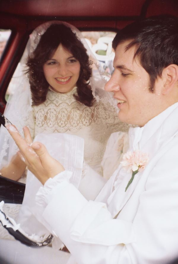 This is our anniversary week and this is what we looked like 35 years ago.   In case you can't tell, this is the moment when we got into my groom's pick up truck.  He was getting ready to drive me away from the Church as his new bride moments after our wedding.  SOMEONE put shaving cream all over the steering wheel and there was confetti coming out of the blower all over the place.