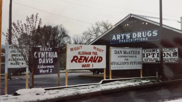 This was a photo taken in 1994 the first time I ran.  Some great volunteers were helping several of us run at the same time and decided to put all our signs together on Main Street.